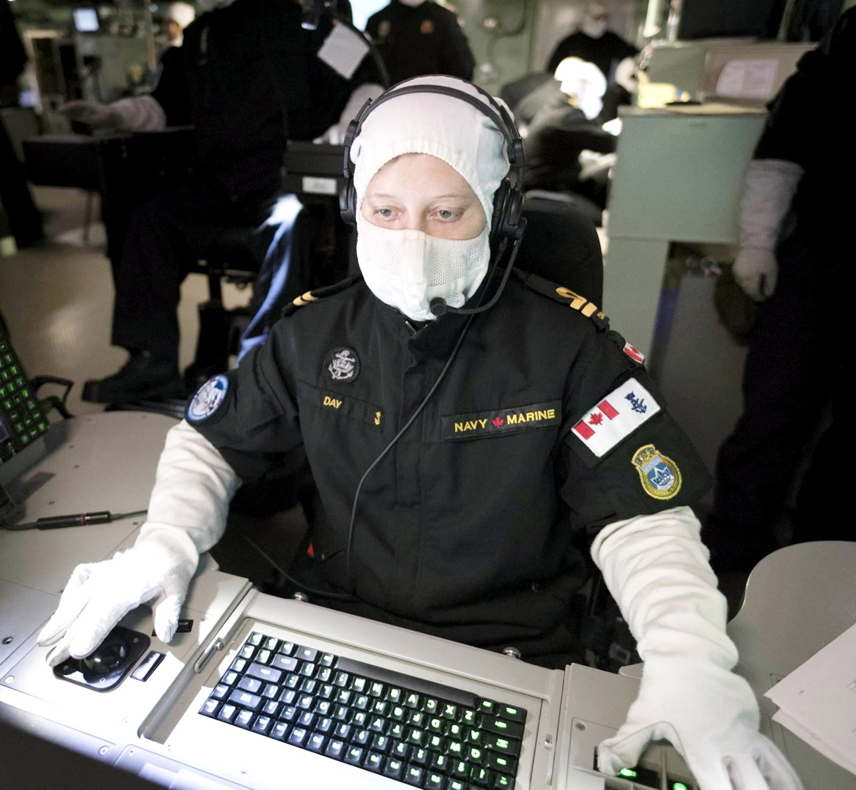 Lieutenant (Navy) Anne-Marie Day works at her station in the Operations Room aboard HMCS Montréal.