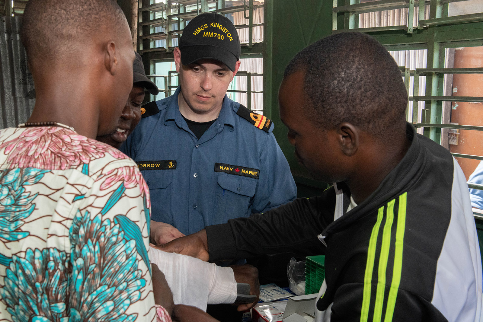 Lt(N) Greg Morrow supervises while local teachers practice first aid at Foyer Don Bosco school in Cotonou, Benin during Operation PROJECTION West Africa on March 1, 2019.