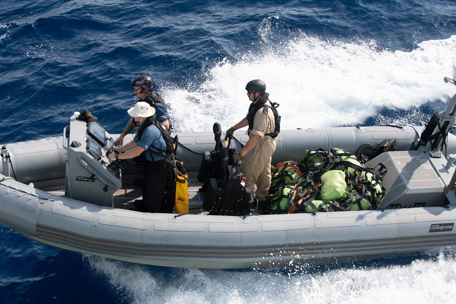 Members of HMCS Regina bring back the first load of seized hashish from a drug smuggling vessel during Operation ARTEMIS on April 6, 2019.