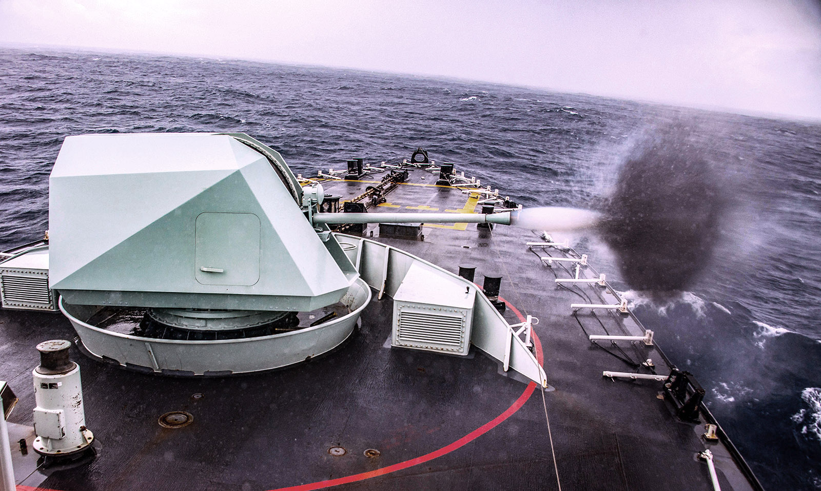 HMCS Regina fires its main 57mm gun.