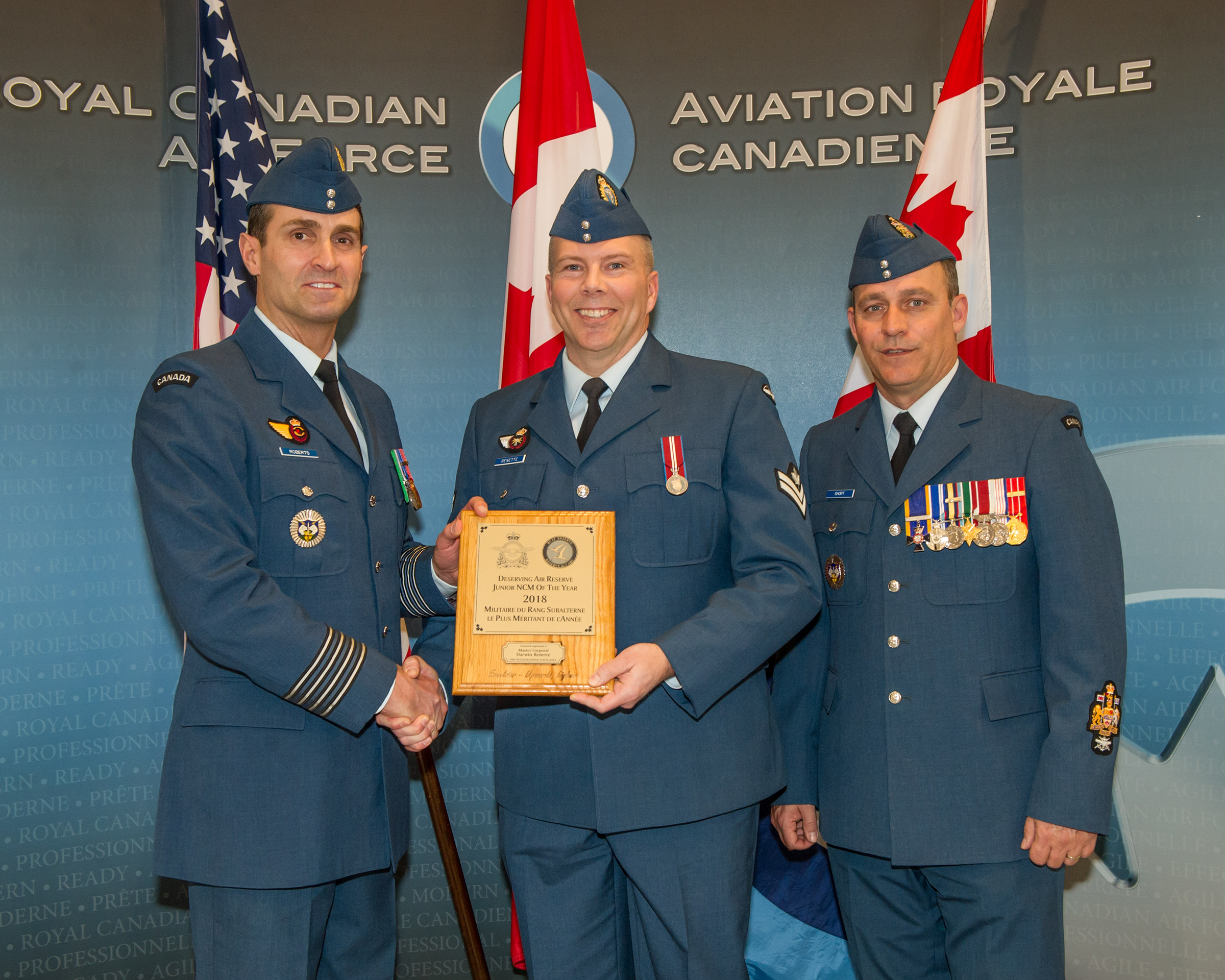 On February 27, 2019, Colonel Mark Roberts (left), commander of 22 Wing, and Chief Warrant Officer John Short (right), 22 Wing chief warrant officer, presented Master Corporal Darwin Renette with the 2018 Air Reserve Deserving Junior Non-Commissioned Member of the Year award. PHOTO: Private Julianna Bullfrog-Wabanonik