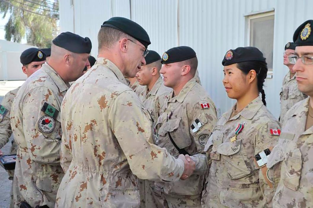 A Master Corporal at the time, Sergeant Amelia Chia receives General Campaign Star medal from Brigadier-General Charles Lamarre with 1 Canadian Mechanized Brigade Group Headquarters and Signal Squadron in the Canada 1 compound, Kandahar Air Field, Afghanistan in December of 2011. Photo: Provided by Sergeant Amelia Chia.