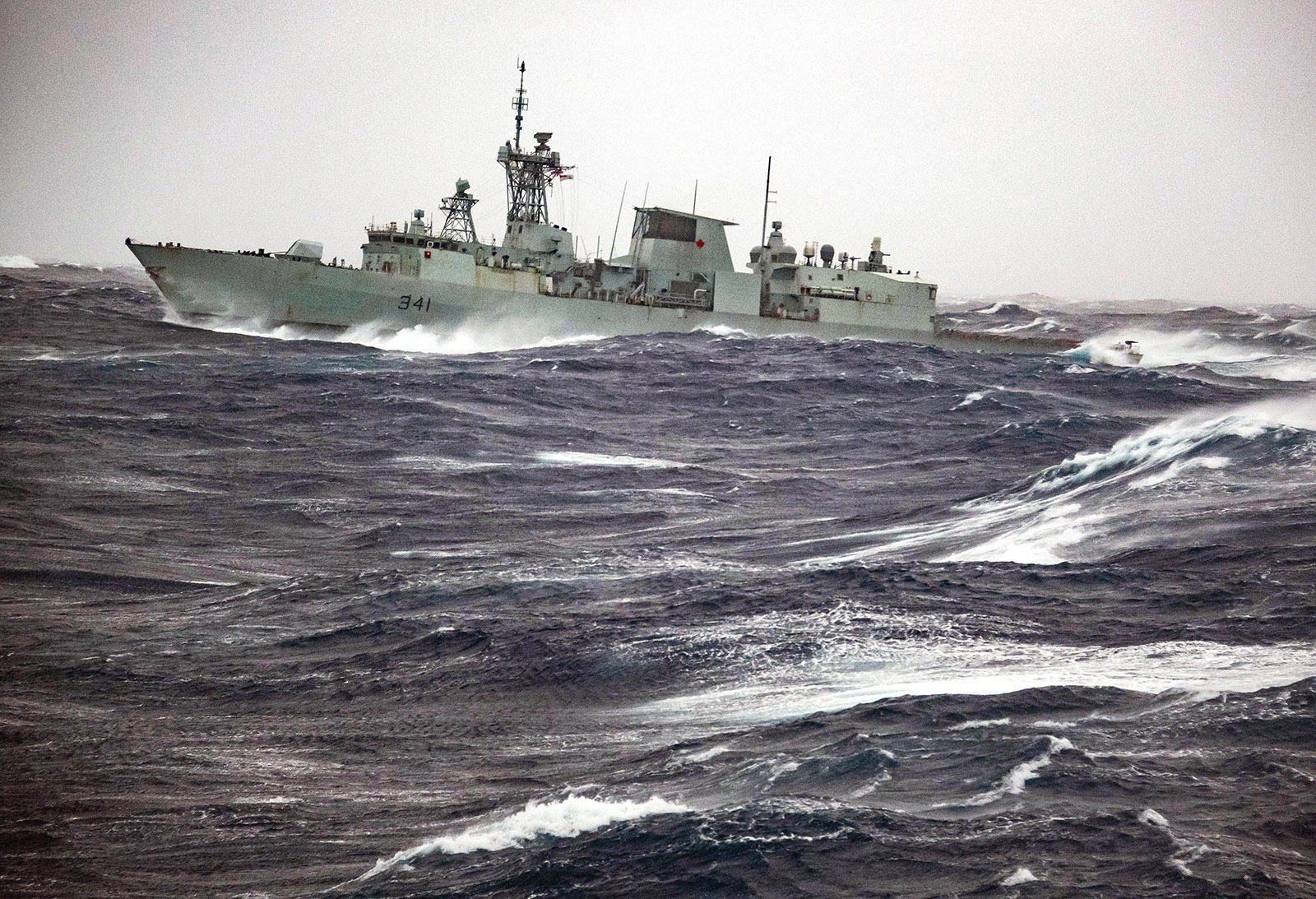 HMCS Ottawa sails through heavy seas in February.