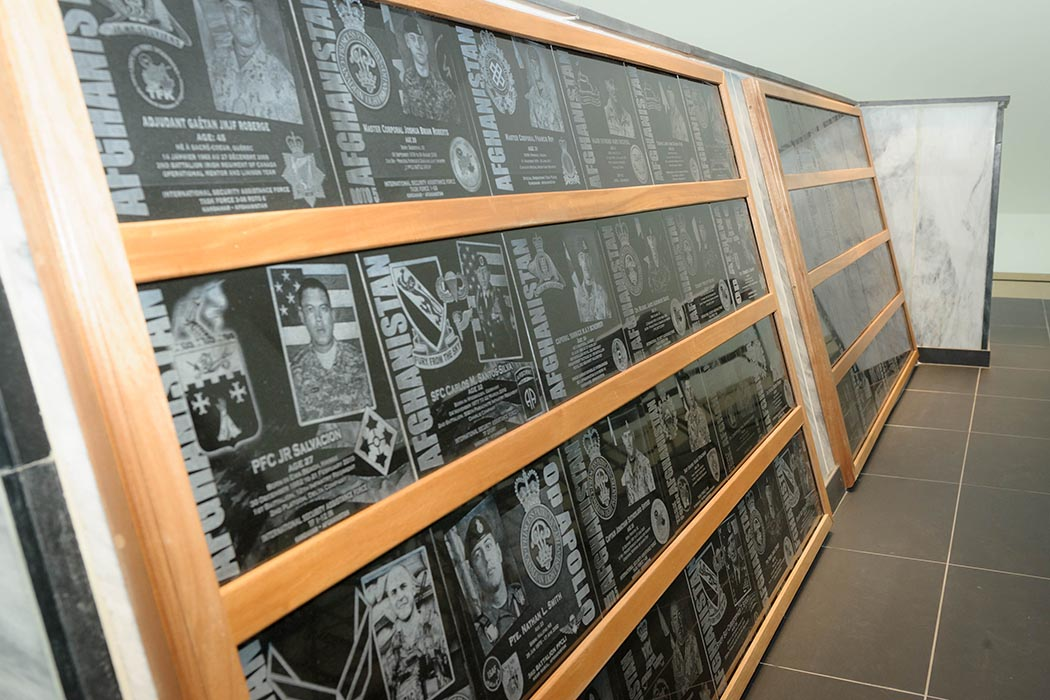 These plaques, with images of Canadians – and Americans under Canadian command – killed in Afghanistan, are part of the Kandahar Cenotaph now on display at National Defence Headquarters (Carling) in Ottawa. Photo: Master Corporal Levarre McDonald, Canadian Forces Support Unit (Ottawa). ©2019 DND/MDN Canada.