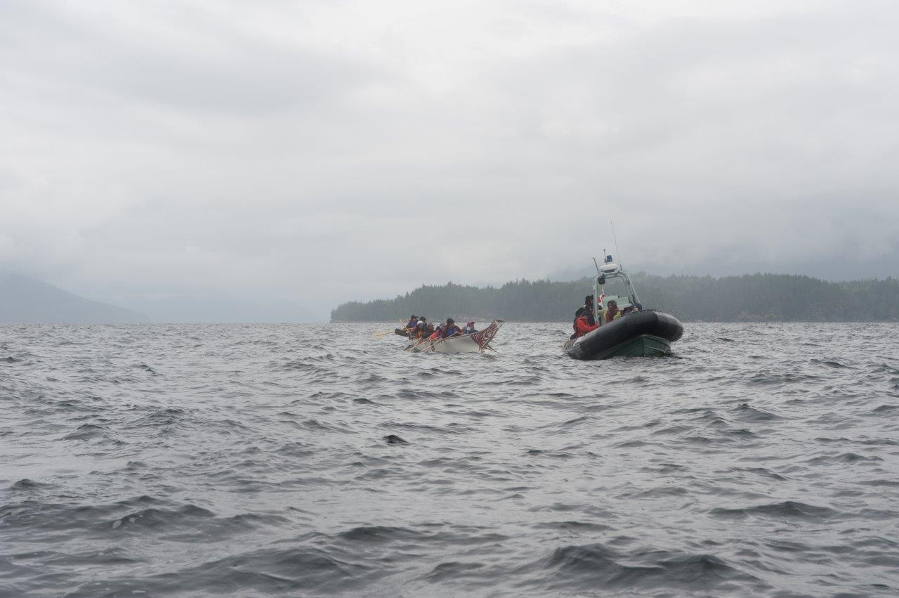 A rigid hull inflatable boat (RHIB) of the Royal Canadian Navy escorts a canoe family during the Pulling Together 2019 canoe journey. The RCN has supported the event with safety boats, planning and logistical support since 2007.