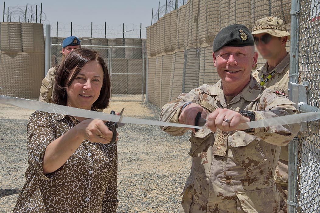 Her Excellency Martine Moreau, Canada's Ambassador to the State of Kuwait, and General Jonathan Vance, Chief of the Defence Staff, cut the ribbon to officially open the National Intelligence Centre in Kuwait on April 26, 2016. Canadian Army Intelligence Operators with knowledge of the languages and cultural practices of countries where they deploy are an invaluable asset. Photo: Operation IMPACT, Department of National Defence. ©2016 DND/MDN Canada