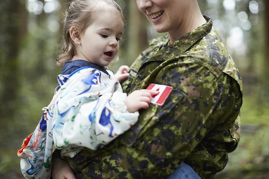A Canadian Army soldier with her young daughter. Effective soldiers need support on many levels – on deployment, during training – and so do their family members. Photo: Canadian Forces Morale and Welfare Services. ©2017 DND/MDN Canada.