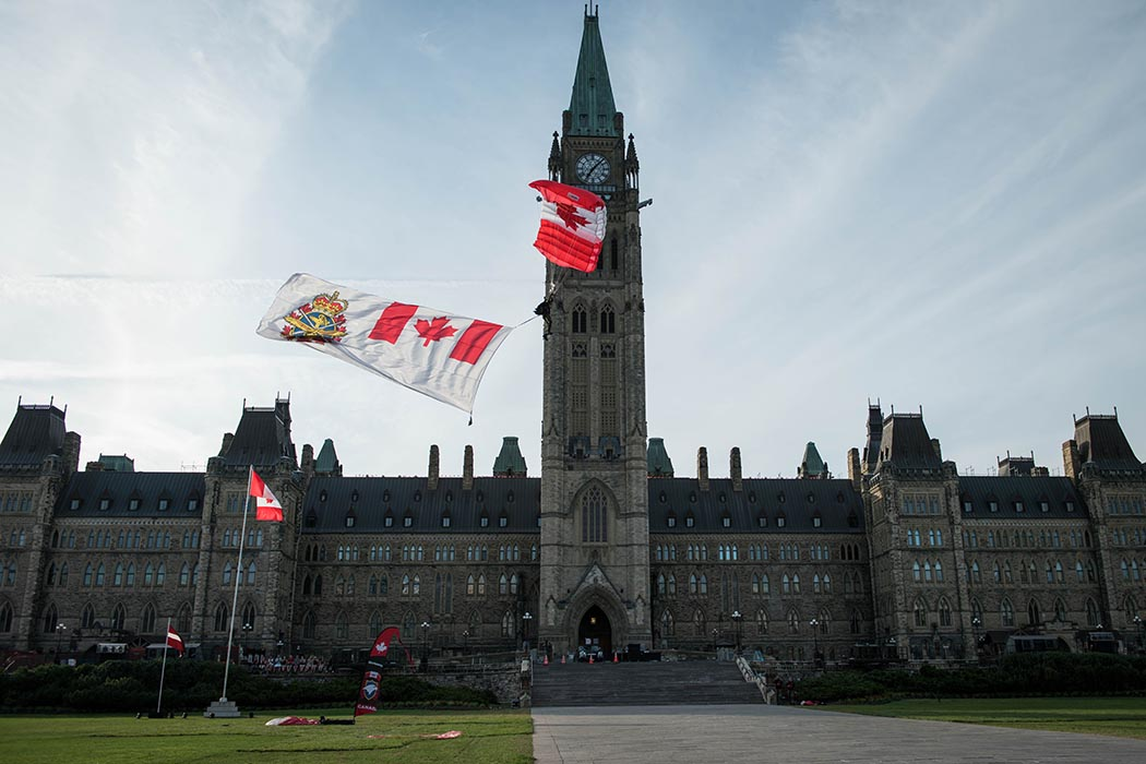 The Canadian Armed Forces Parachute Team, The SkyHawks, perform aerobatic parachute formations during Fortissimo 2019 on Parliament Hill in Ottawa, Ontario, July 18, 2019. Photo: Ordinary Seaman Alexandra Proulx, Army Public Affairs. ©2019 DND/MDN Canada.