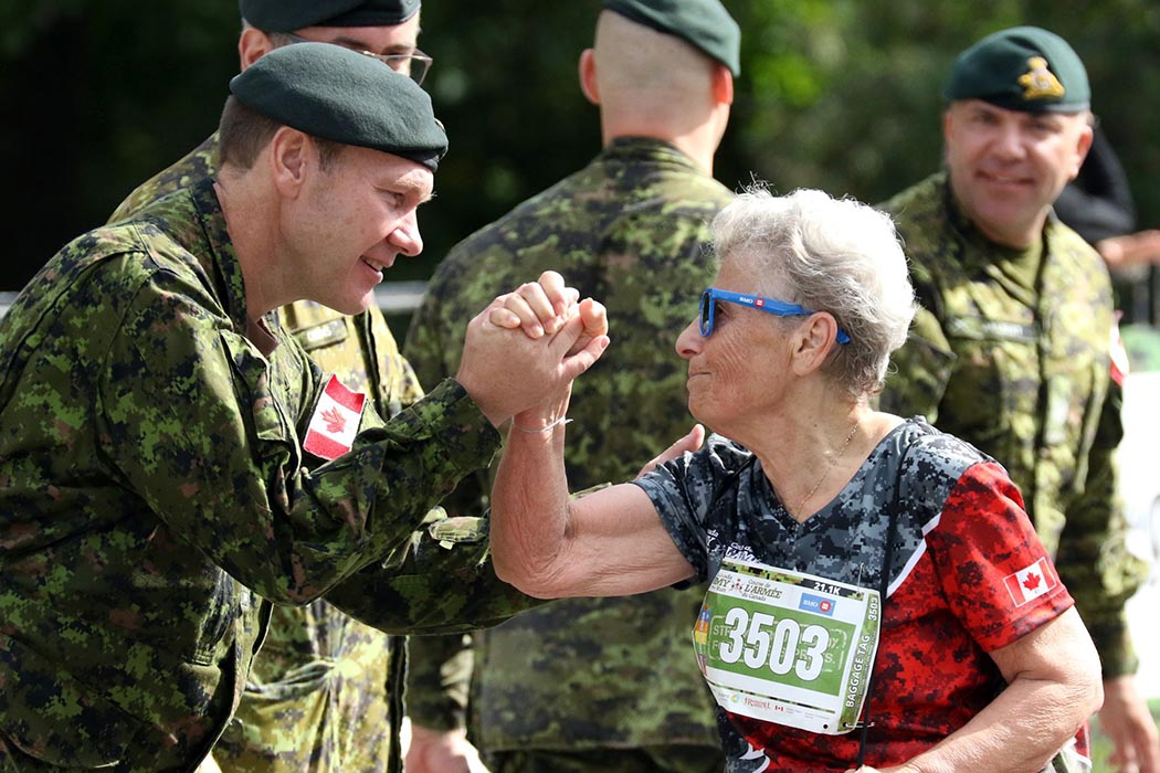 A member of the Canadian Armed Forces congratulates a participant at the finish line of the 2018 edition of Canada Army Run. Photo: Mike Pinder, Official event photographer. ©2019 DND/MDN Canada.