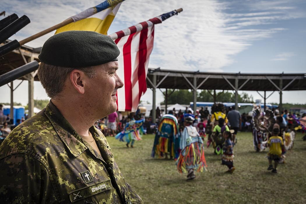 Captain Oliver Edwards, a padre with Bold Eagle 2019, observes the dancers of the 28th Annual Muskoday First Nation Traditional Powwow in Muskoday, Saskatchewan on August 3, 2019.