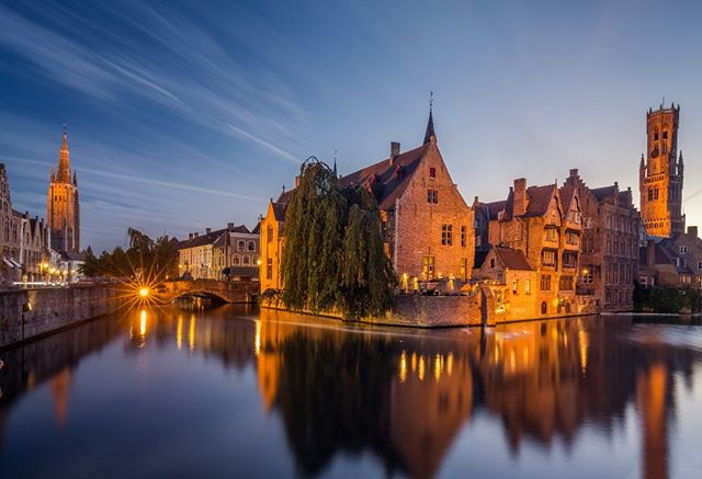 Blue hour shot of historic medieval buildings along a canal. #bruges #belgium #spring#blossom#almond#israel#master_gallery#ig_shotz_travel #ig_shotz #ourplanetdaily#awesome_photographers#master_gallery#ourplanetdaily #ig_worldclub #phototag_it#igpodium #main_vision #awesomeearth#thebestdestination#igglobalclub #thebest_capture#fantastic_earth #discoverglobe#wonderful_places #earthvacations#awesome_photographers #big_shotz #colors_of_the_day#landscapephotography #landscape#traveladdict