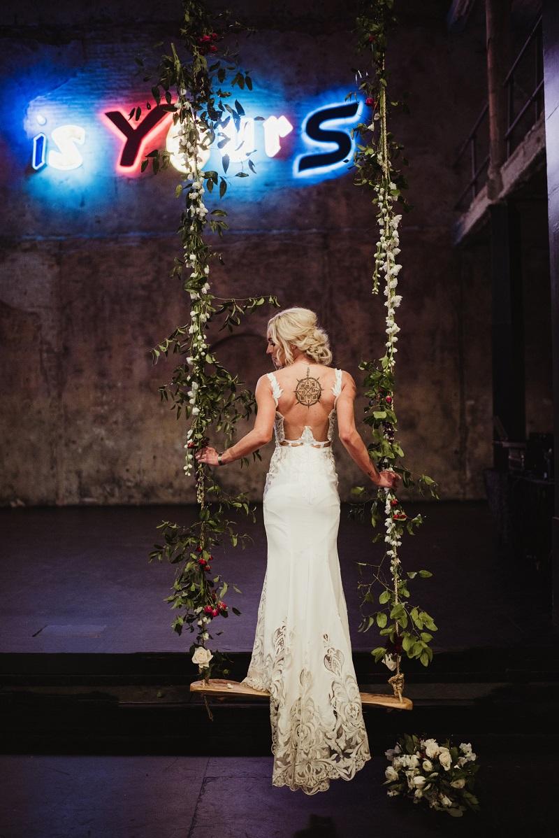wood swing at weddings, indoor swing, floral on swings, studio fleurette, aria minnesota, minneapolis florist.jpg