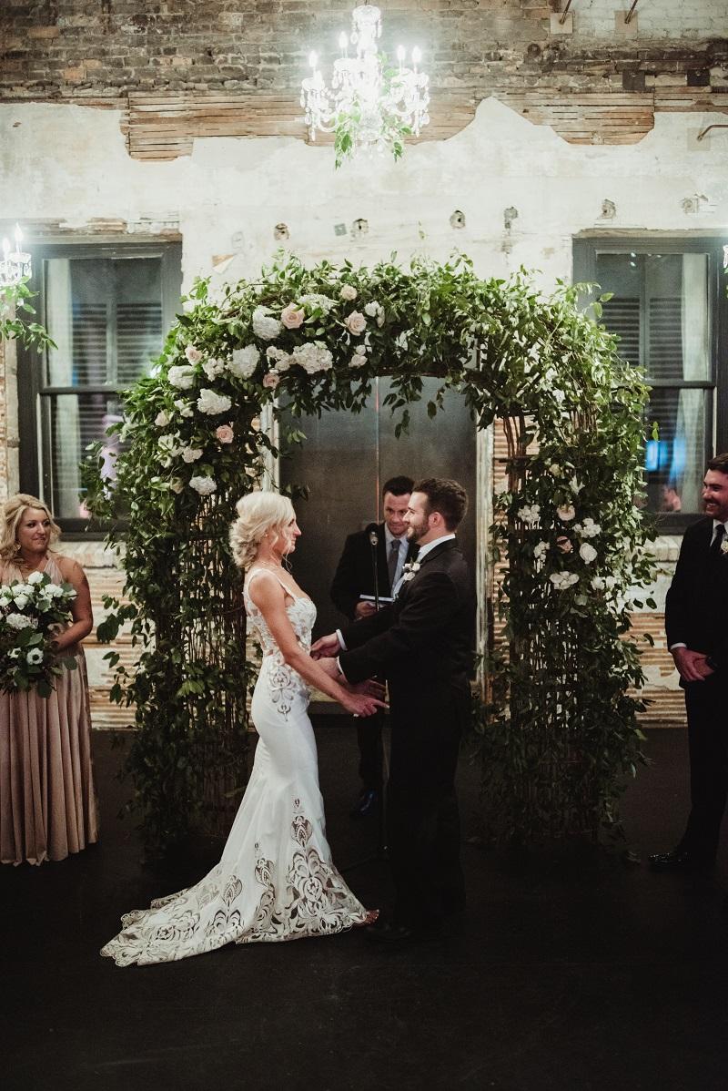 wedding arch, wild smilax vine on arch, greenery chandelier, aria minneapolis, studio fleurette.jpg