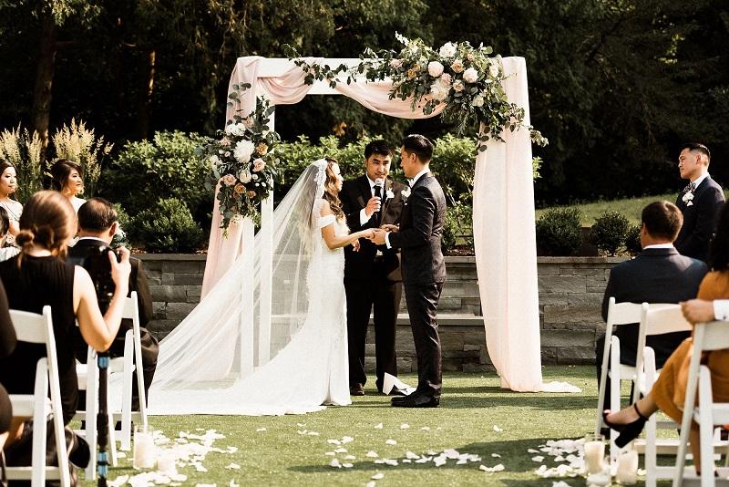 outdoor wedding hutton house, hutton house courtyard wedding, studio fleurette, floral arch.jpg
