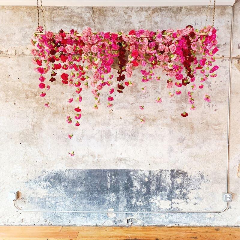 studio fleurette, hanging carnation backdrop, hanging floral chandelier, bachelor farmer wedding.jpg