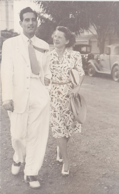 Mel and Annalee walking together through Manila on their wedding day.