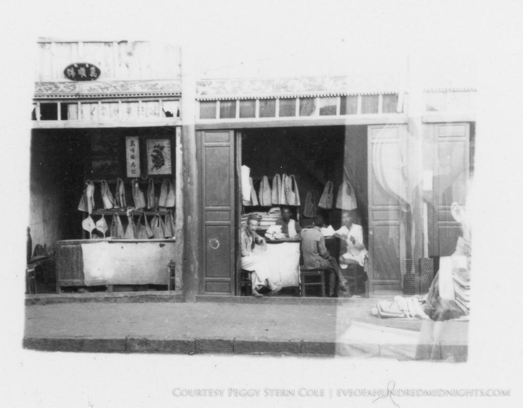 Man inside shop looking at Camera.jpg