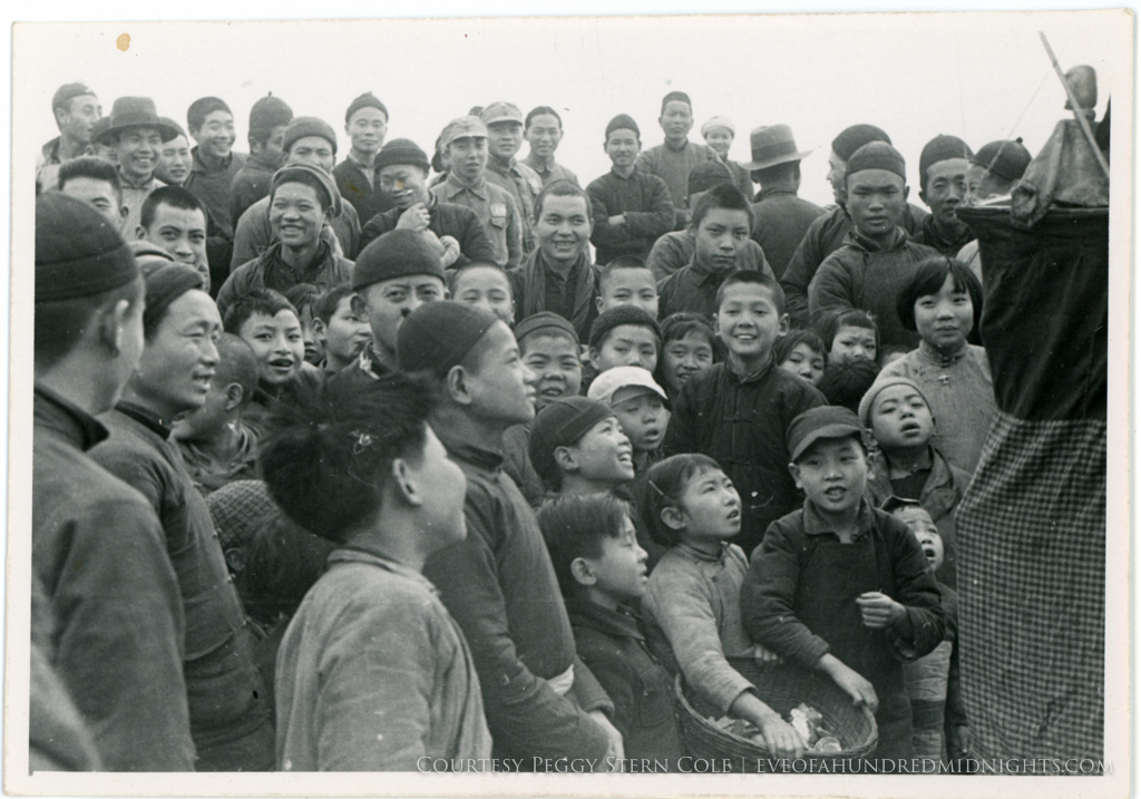 Chinese kids (and adults) at apparent puppet show.jpg
