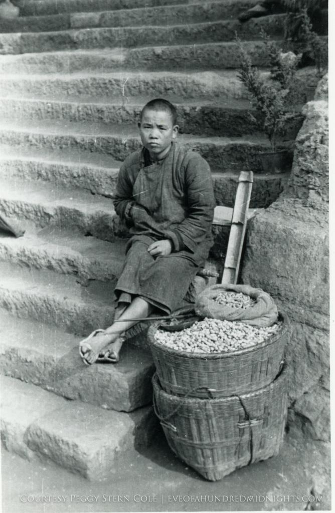 Chungking Peanut Vendor Boy on Stairs.jpg
