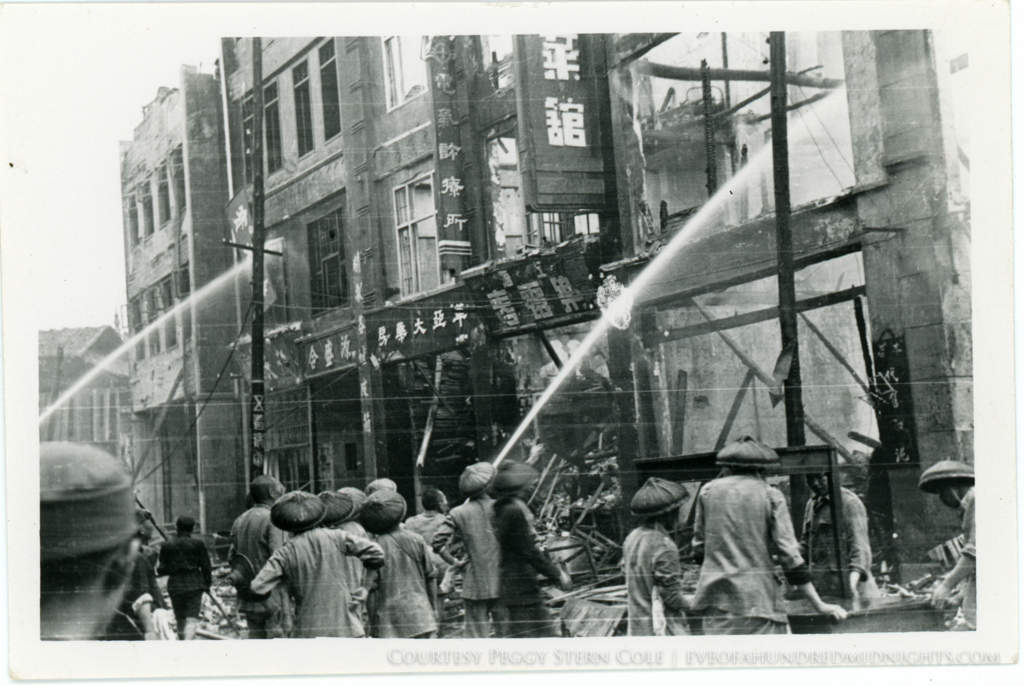 Dousing flames on Chungking building facade.jpg