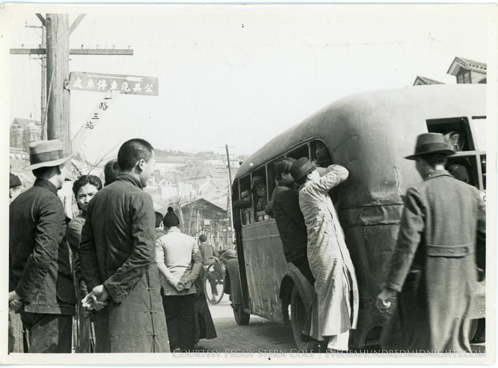 Men Riding on Chungking Bus.jpg