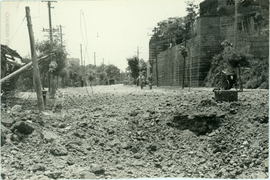 Rubble Strewn Chungking Street Shot From Down Low.jpg