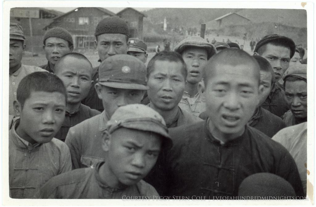 Angry or skeptical chinese men looking at Camera from small print.tif.jpg
