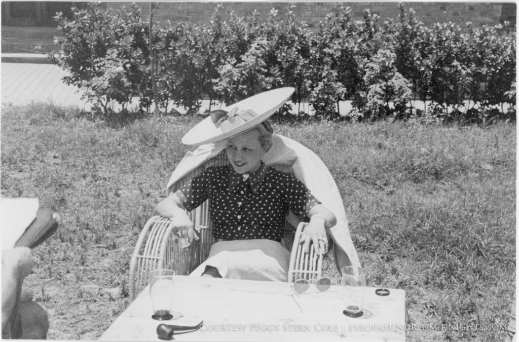 Student in Large Hat In Field By Vines.jpg