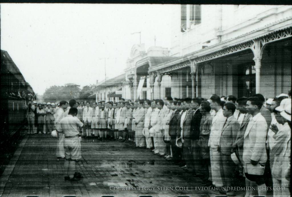 Crowd at Train Station From Exposed Negative [not cheering].jpg