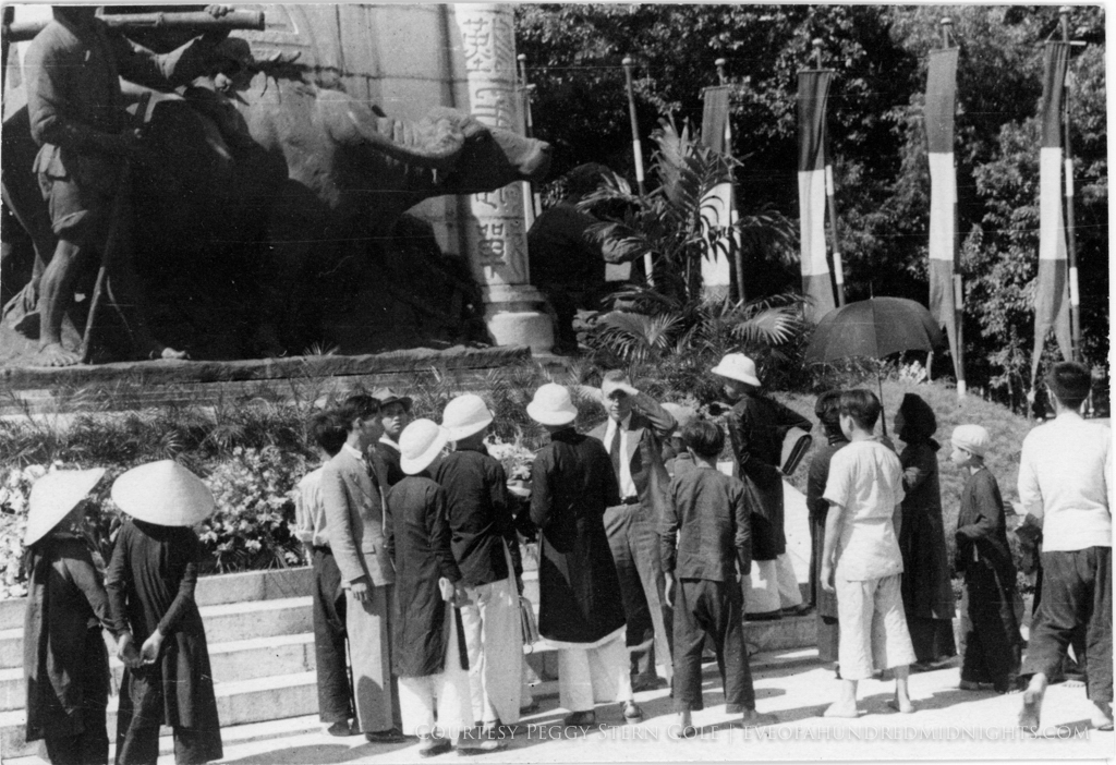 Crowd at base of Indochina Monument With Friend Looking at Mel.jpg