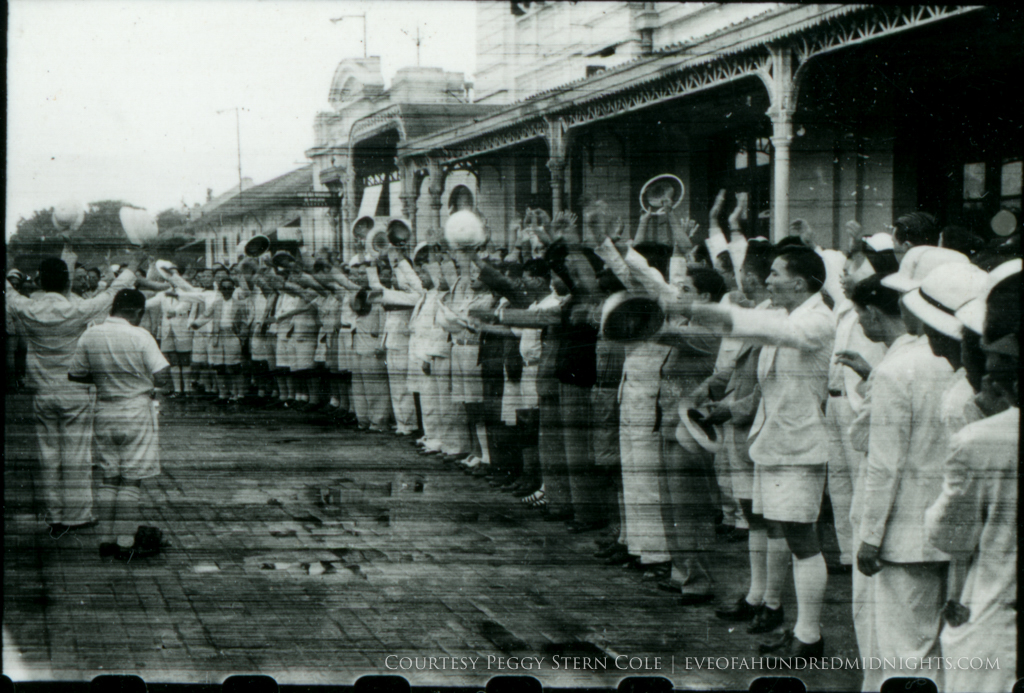 Crowd cheering at train station from exposed negative.jpg