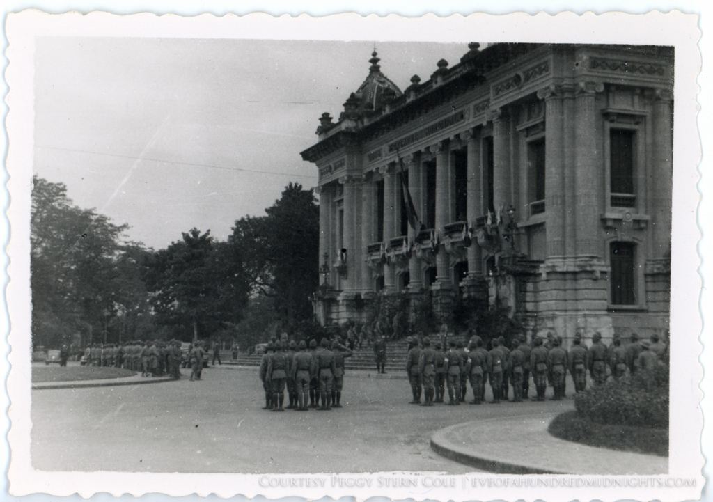 Japanese Troops in Formation at theatre municipal in Hanoi wiht huge Japanese flag.jpg