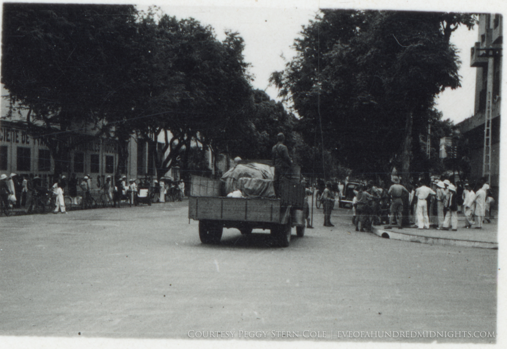 Japanese Soldier on Truck Passing Indochina intersection.jpg