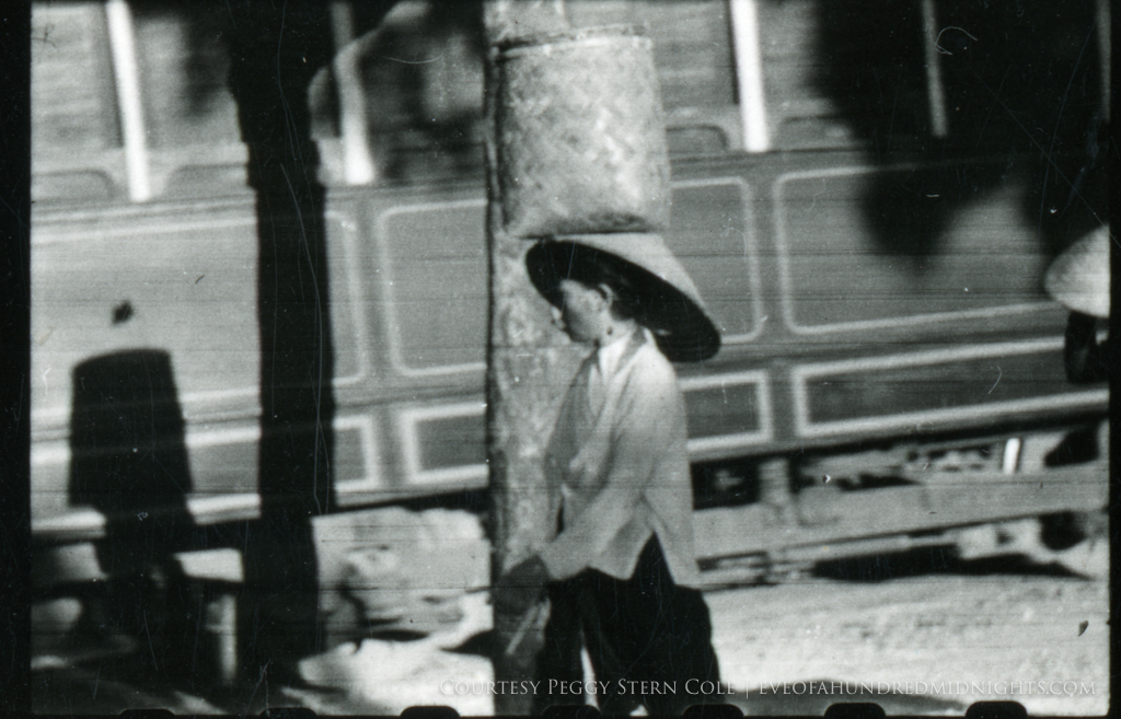 Lady With basket on head in Hanoi.jpg