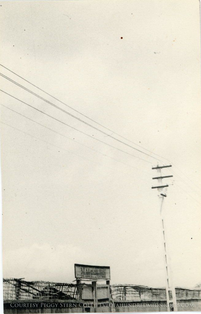 Shot of fence and power lines at warehouse somewhere.jpg