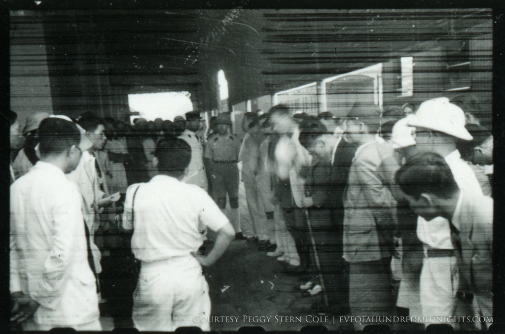 Somewhat exposed shot of french and japanese meeting at train station.jpg