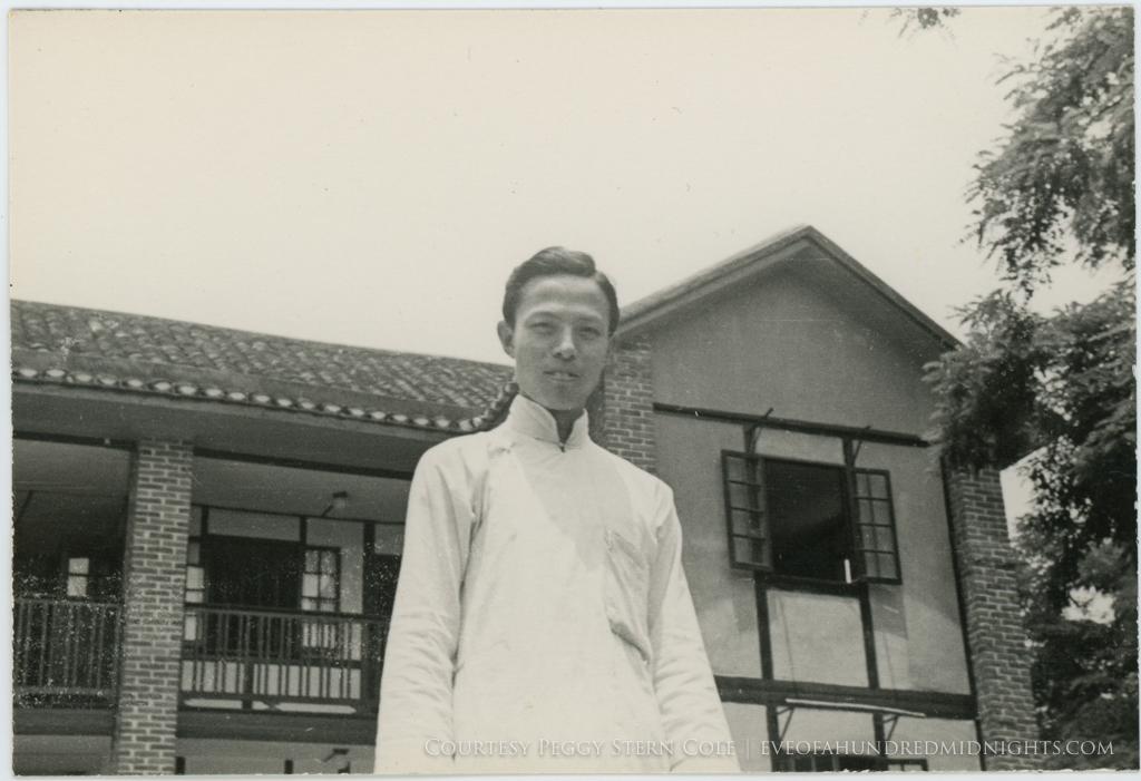 Liao in front of press hostel.jpg