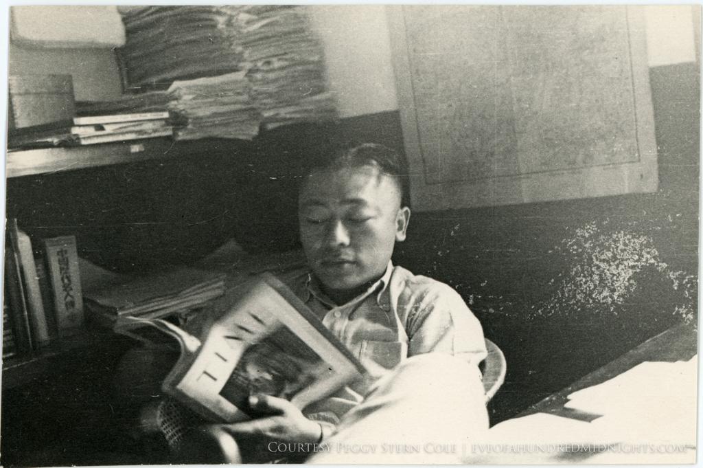 Man in Press Hostel Reading Time Magazine.jpg