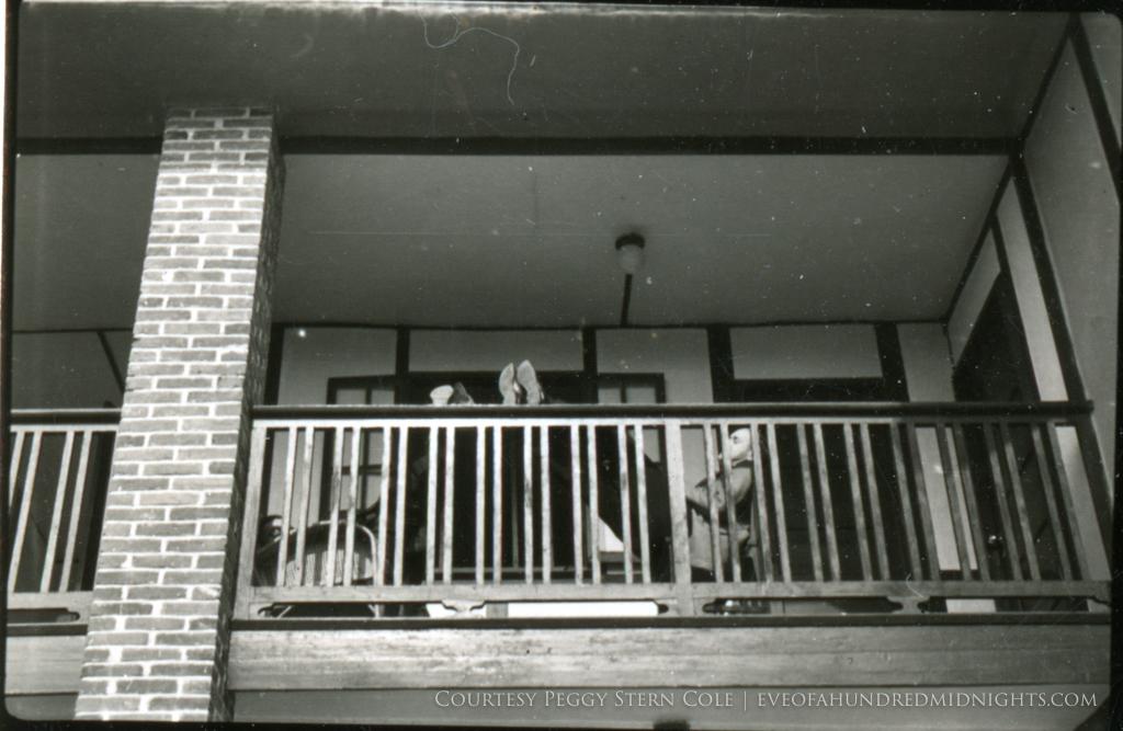 Men sleeping on Press Hostel Balcony.jpg