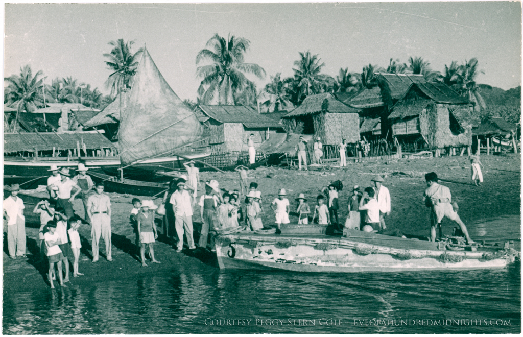 Boat pulling up at Philippines Village.jpg