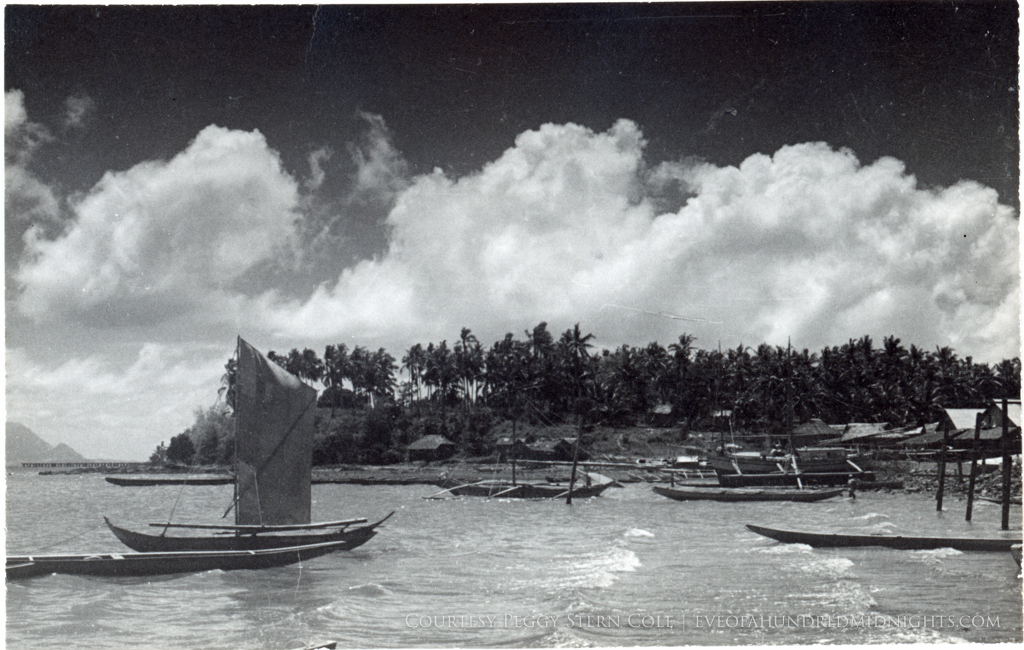 Boats at Philippines Shore with stark clouds.jpg