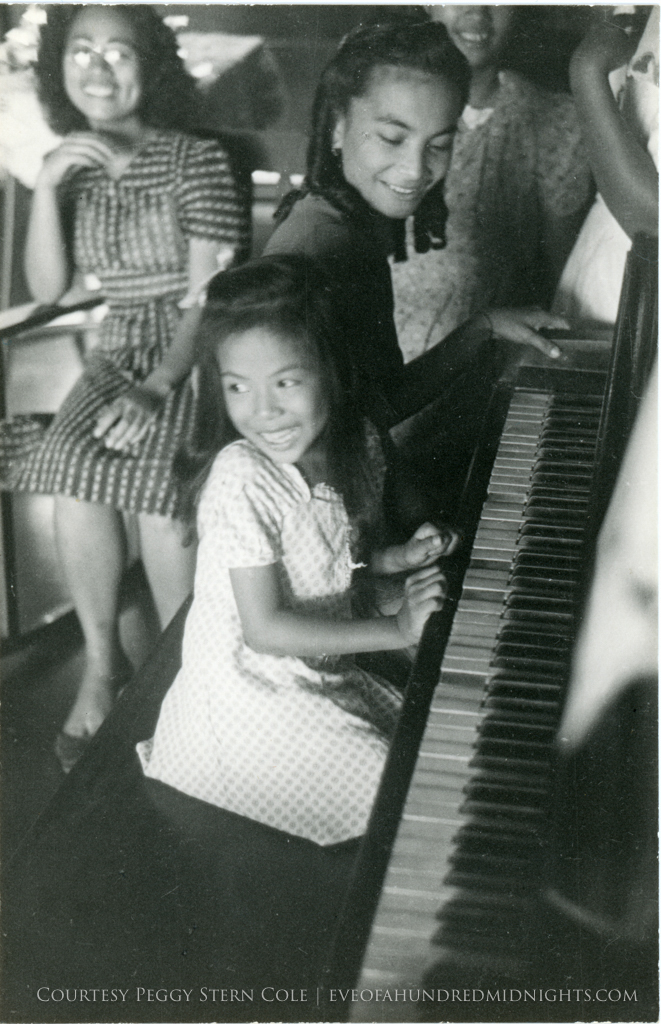 Girls playing piano in philippines.jpg