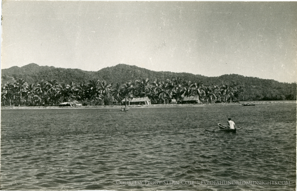 Pola Bay with Banca rowing in foreground.jpg