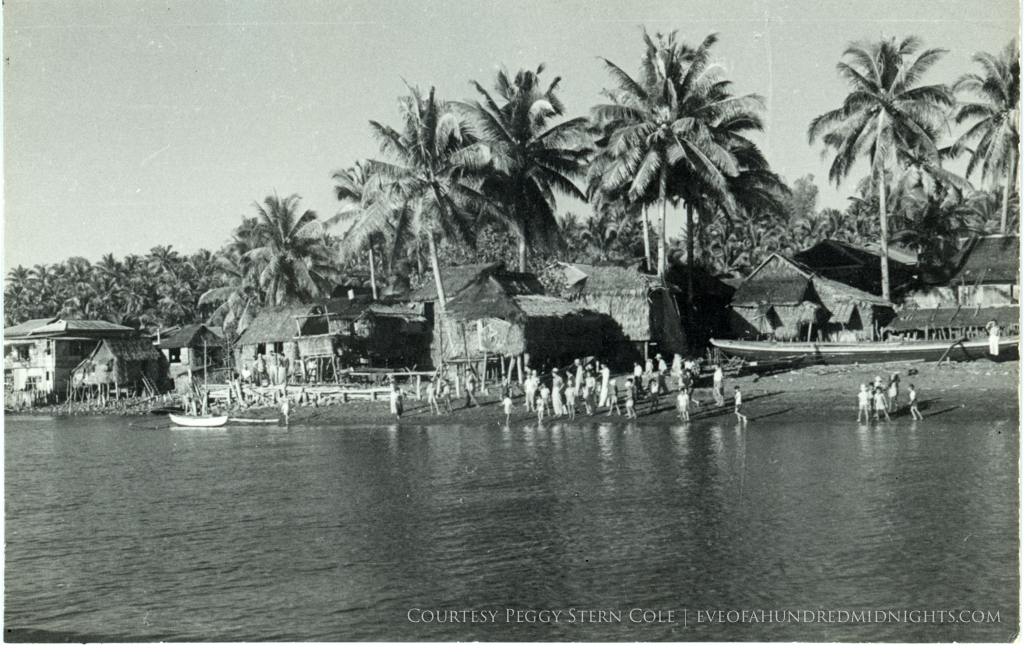 Shacks on Philippines Beach With Villagers.jpg