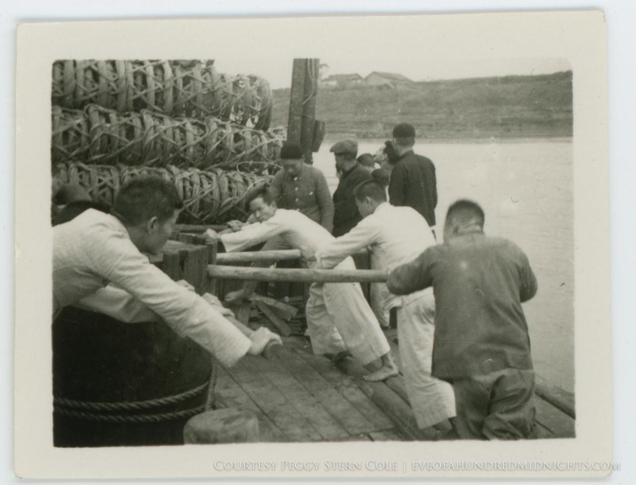 Men pushing wheel on Pearl River Barge.jpg