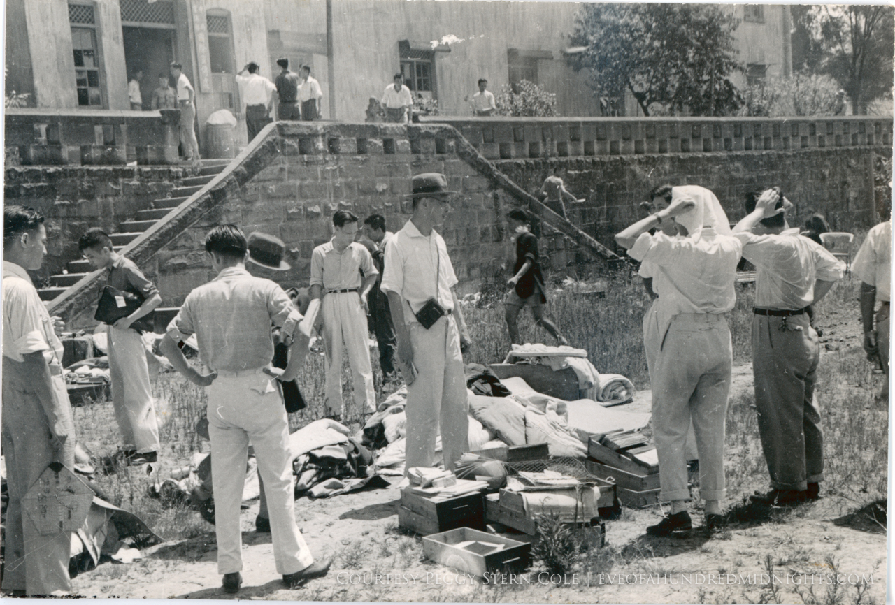 People sorting through bombed goods.jpg