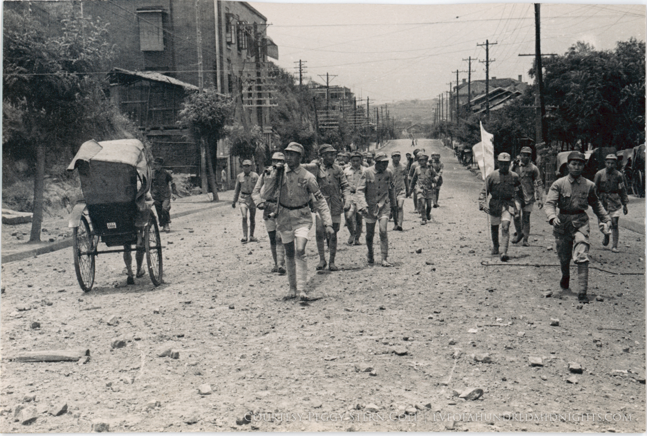 Soldiers Walking Down Rubble-Strewn Chungking Road.jpg