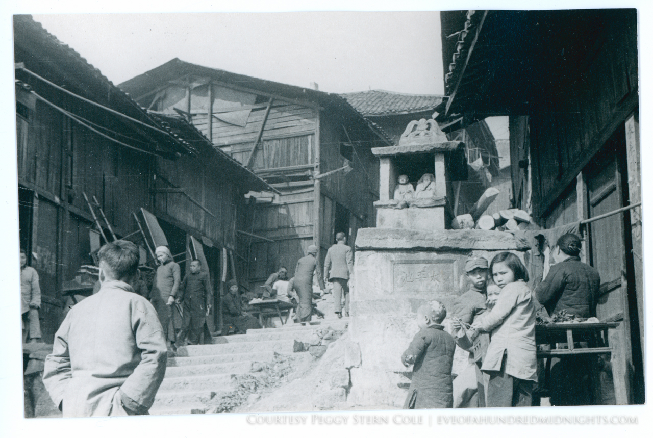 Chungking steps with stone shrine and kids.jpg