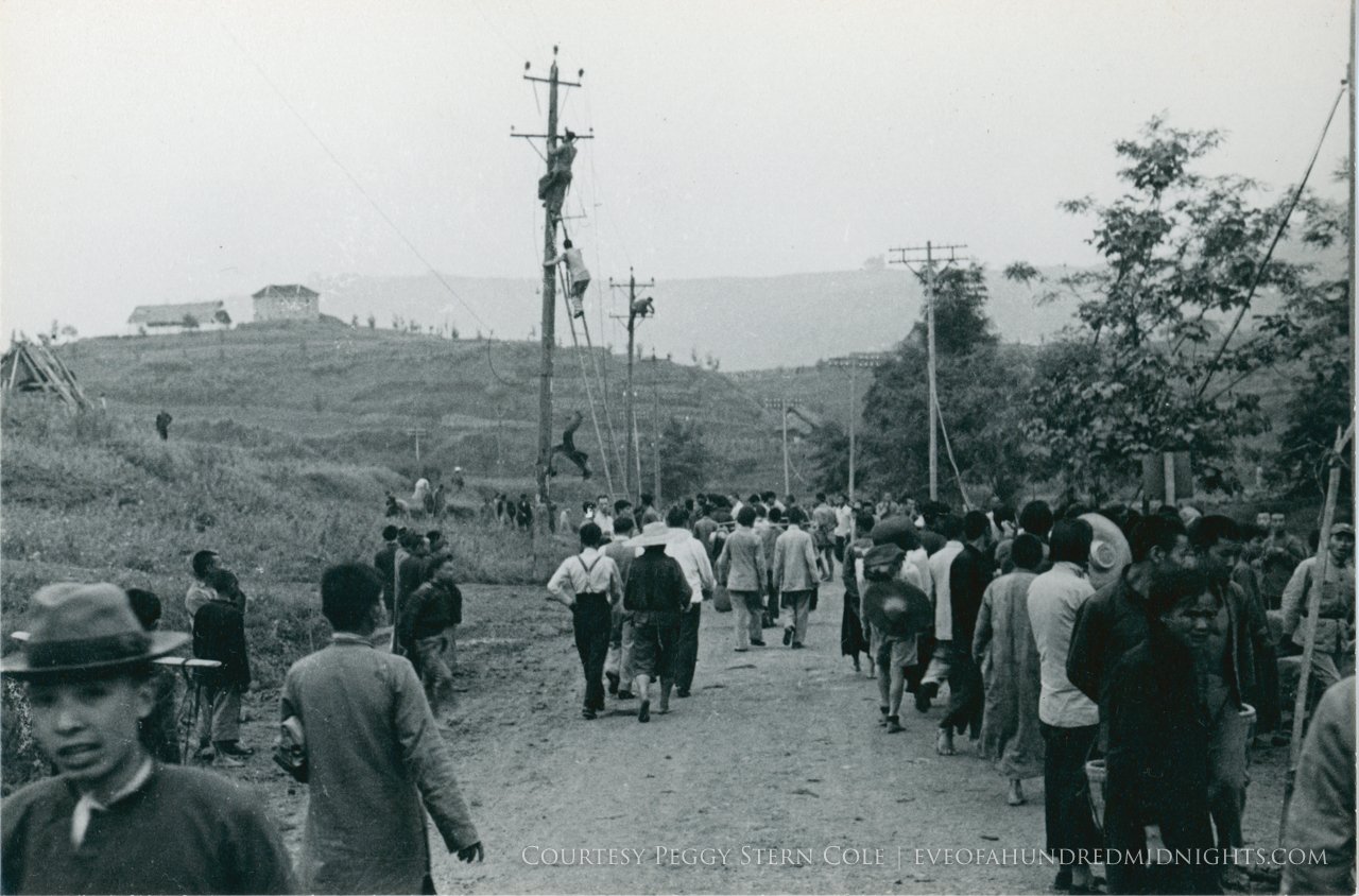 Crowds as men climb sides of Chungking Telephone poles.jpg