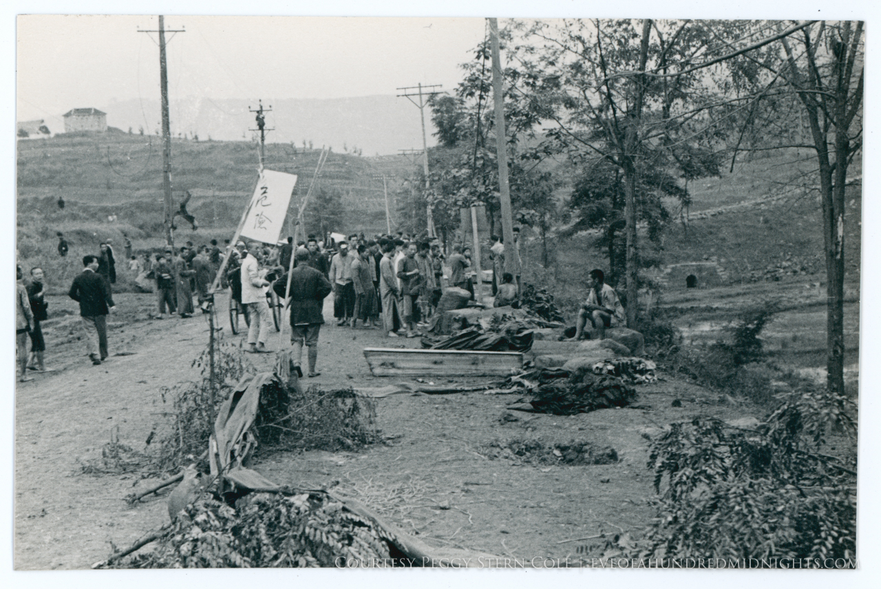 Crowd in dirt road.jpg